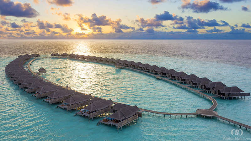 Hi_AKIH_62672287_Over_Water_Villas_Sunset_aerial